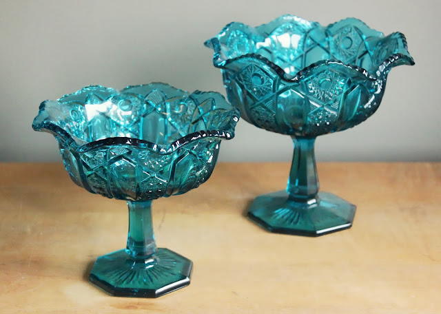 Aqua blue pedestal bowls in assorted patterns available for rent from www.momentarilyyours.com, $4.00 for set.