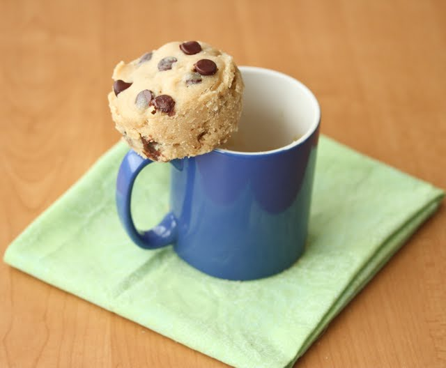 photo of the cookie balanced on the edge of a coffee mug