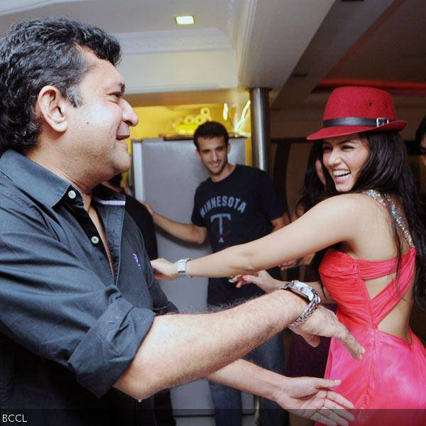 Sana Khan shakes a leg with Ken Ghosh during her 26th birthday celebrations in Mumbai on August 21, 2013. (Pic: Viral Bhayani)