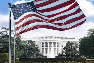 an American Flag flying near the White House in Washington, D.C.