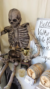 Glaser Distillery being supervised by a skeleton at Bite of Oregon