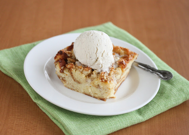 photo of a slice of Hawaiian Bread Pudding topped with ice cream