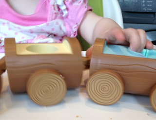Maegan enjoyed the easy push along movement of Huffty's train