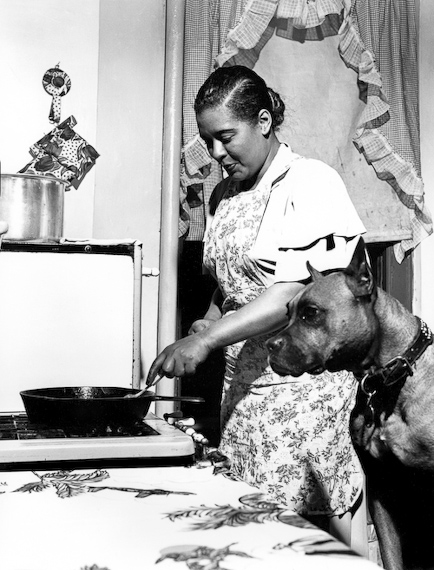 Billie Holiday and Mister  in the kitchen