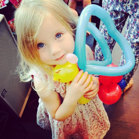 Maegan Darcie Clement with a Butterfly Balloon Model