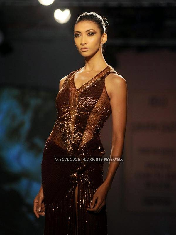 Lakshmi Rana showcases a creation by designer Gaurab Gupta on Day 3 of India Couture Week, 2014, held at Taj Palace hotel, New Delhi.