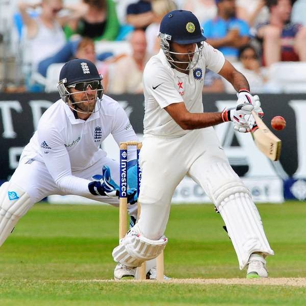 India's Bhuvneshwar Kumar plays a shot watched by England's Matt Prior, left, during day five of the first Test between England and India at Trent Bridge cricket ground, Nottingham, England, Sunday, July 13, 2014.