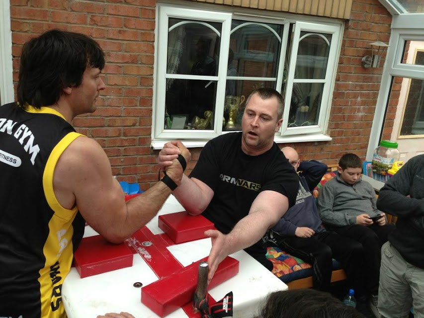 "Devon Larratt - Neil Pickup - right hand training at ""The FreaKShop"" - 21 April 2013, Great Britain"