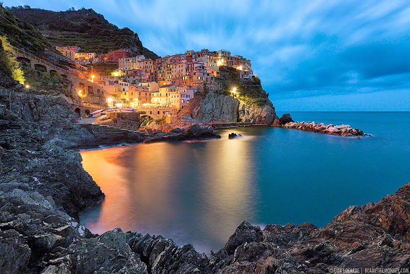 A breathtaking twilight in Manarola, one of the most beautiful towns in Le Cinque Terre. Photographer Elia Locardi
