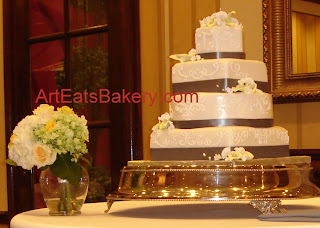 Four tier hexagon, square and round custom wedding cake with royal icing  designs and white and yellow suage flowers