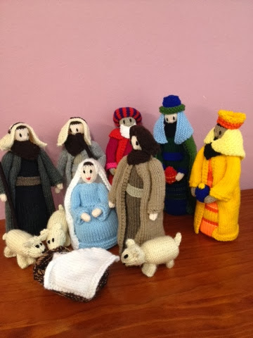 Baby Jesus in the manger with wise men and sheppards