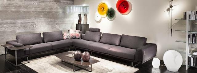Vistosi iluminando el Salón del mueble con un sofá de Natuzzi Italia
