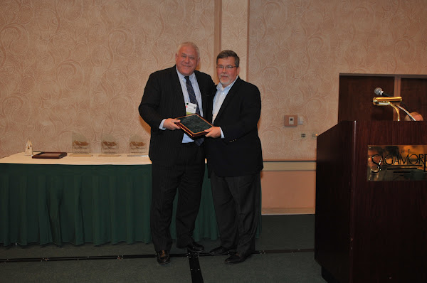 Steven Goldstein (left), President and Chief Executive Officer of Strong Memorial Hospital, receives Honorable Mention for HANYS' 2011 Community Health Improvement Award. Handing out the award is Joseph McDonald, President and Chief Executive Officer of Catholic Health System (right).