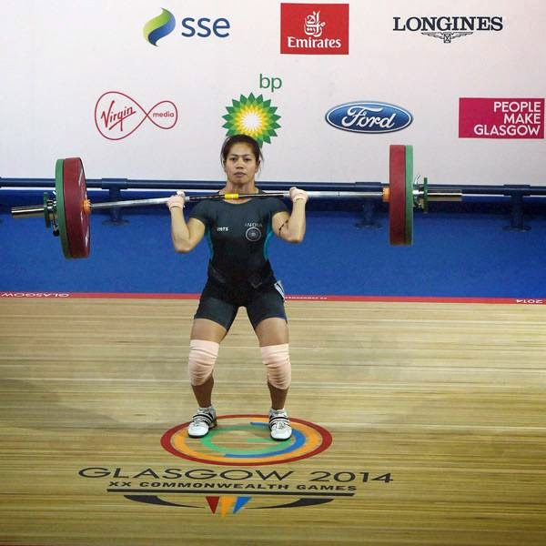 India's Sanjita Khumukcham completes a lift during the 48-kg women's weightlifting event at the Commonwealth Games in Glasgow, Scotland