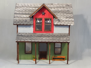 This house was scratch built using instructions from an article in Dollhouse Miniature Magazine Issue#.
