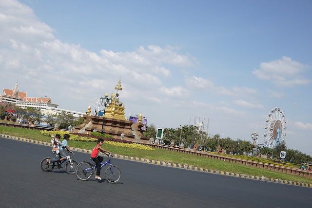 kids riding bicycles at a traffic circle
