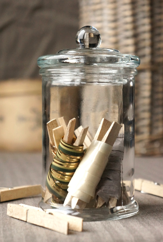 Ribbons on clothespin in a glass jar