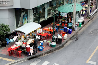 Small restaurant on a street corner in Bangkok Thailand