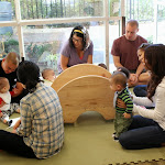 Parents enjoy getting to know each other as their babies explore.