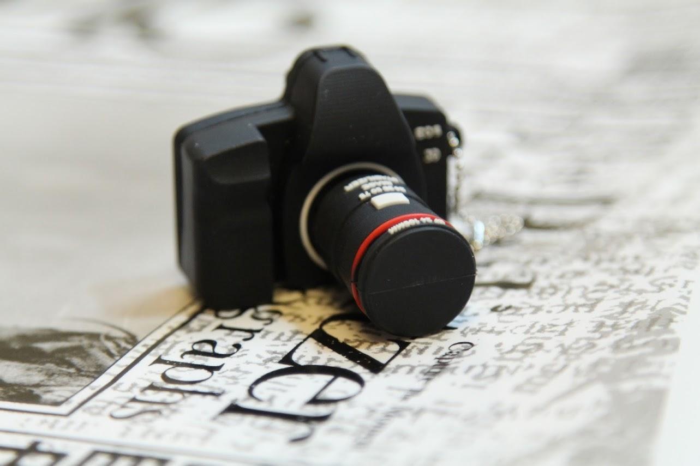 *好康贈送:1/25~2/7 「普立茲新聞攝影獎典藏明信片組+相機造型隨身碟」(已截止) 4