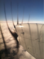 airplane propeller above clouds