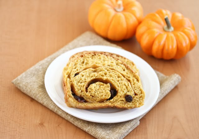 photo of slices of Pumpkin Cinnamon Swirl Bread on a plate