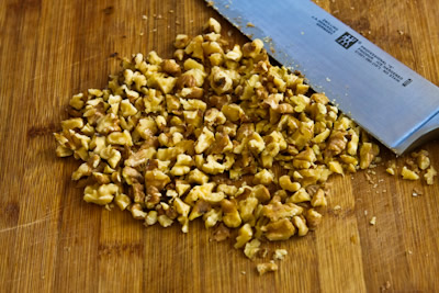 chopping walnuts for Made-from-Scratch Low-Sugar and Whole Wheat Bran Muffins with Apple and Walnuts found on KalynsKitchen.com