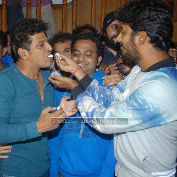 A Harsha and Shivarajkumar during the latter's birthday celebrations, in Bangalore.