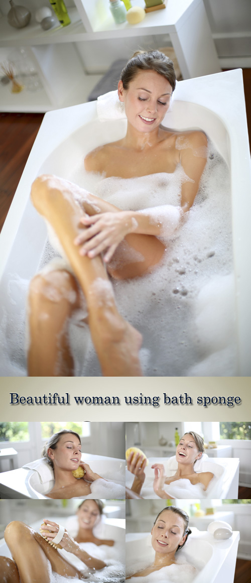 Stock Photo: Beautiful woman using bath sponge