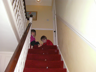 arranging toys halfway up the stairs