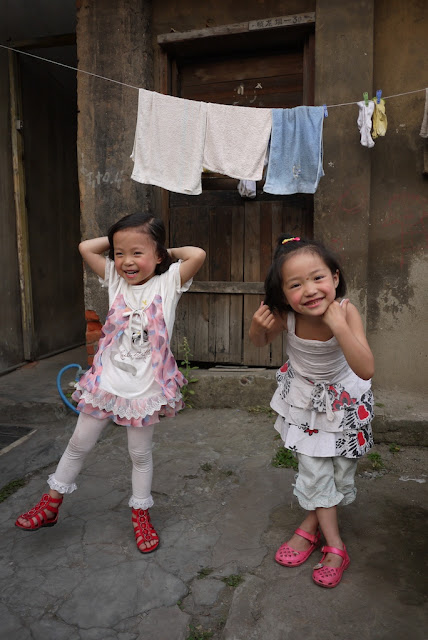 two Chinese girls posing for a photograph