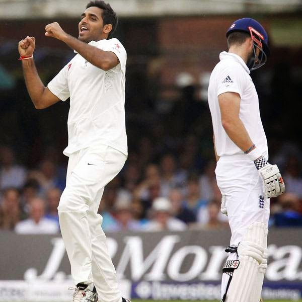 India's Bhuvneshwar Kumar (L) celebrates taking the wicket of England's Ben Stokes for 0 runs during the third day of the second Test cricket match between England and India, at Lord's Cricket Ground in London, England on July 19, 2014.