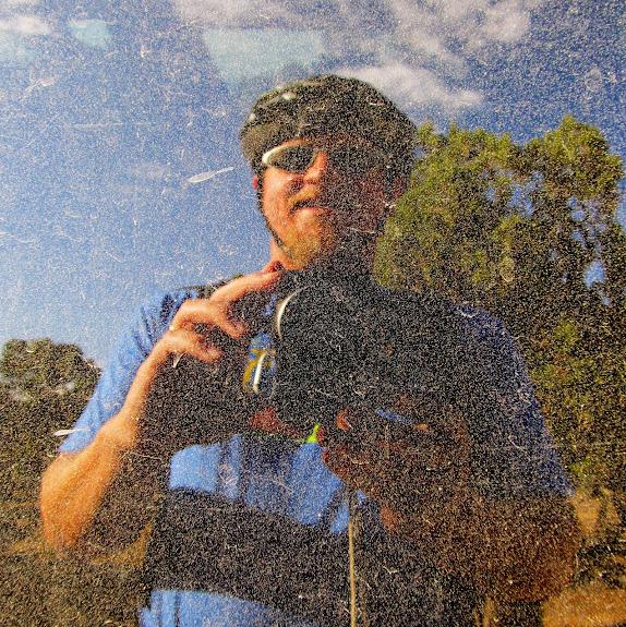 Selfie in the dirty Jeep window