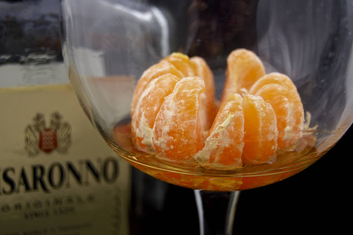 satsuma in a glass with amaretto