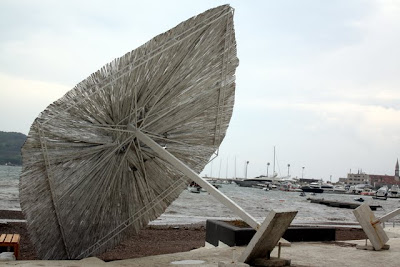 Beach umbrella in Budva Montenegro after a storm