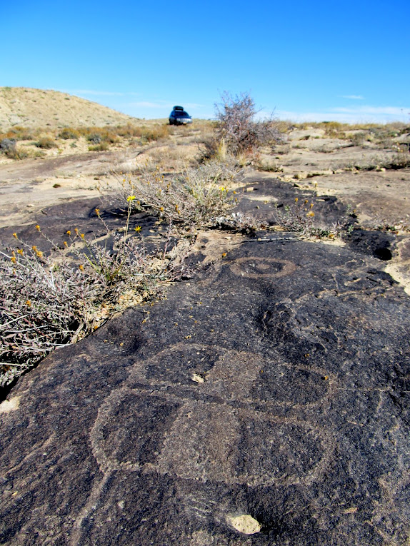 Footprint petroglyphs at ground level