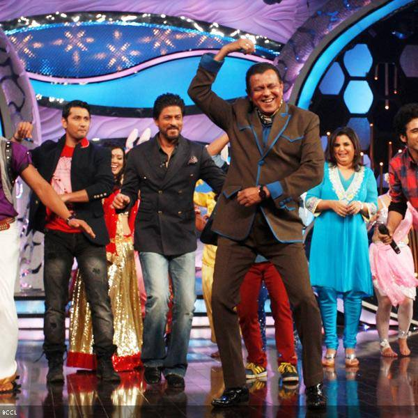 Original Disco Dancer Mithun Chakraborty performs in presence of Shah Rukh Khan and Farah Khan, on the sets of dance reality show DID Super Moms, in Mumbai, on July 3, 2013. (Pic: Viral Bhayani)