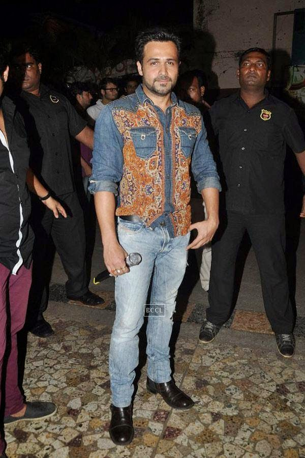 Emraan Hashmi gives away movie tickets of a recent Bollywood blockbuster to promote his upcoming film Raja Natwarlal at Gaitey, in Mumbai, on July 26, 2014. (Pic: Viral Bhayani)