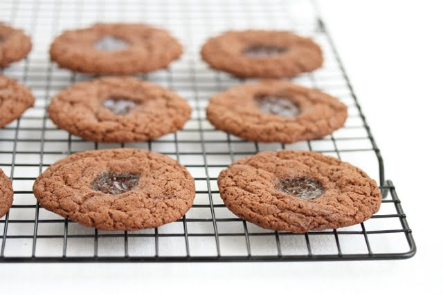 photo of Chocolate Peanut Butter and Jelly Cookies on a baking rack