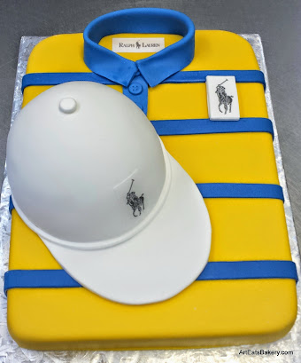 Custom Mens Yellow And White Birthday Cake Featuring Fondant Covered Shape Of A Sporting Polo Shirt Hat With Edible Emblems