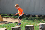 The log stumps in the natural playground invite children to climb and jump.