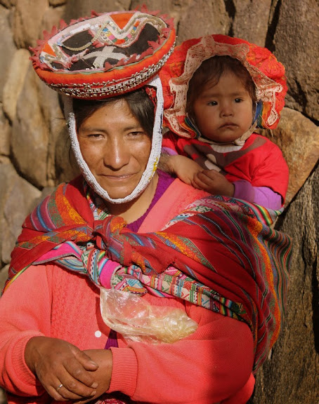 A woman carrying her little baby in Lare village