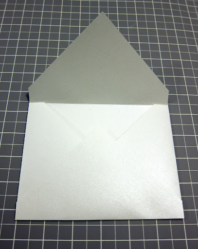 I folded the two side flaps in toward the center of the envelope and secured the bottom flap to each of them with double-sided tape.