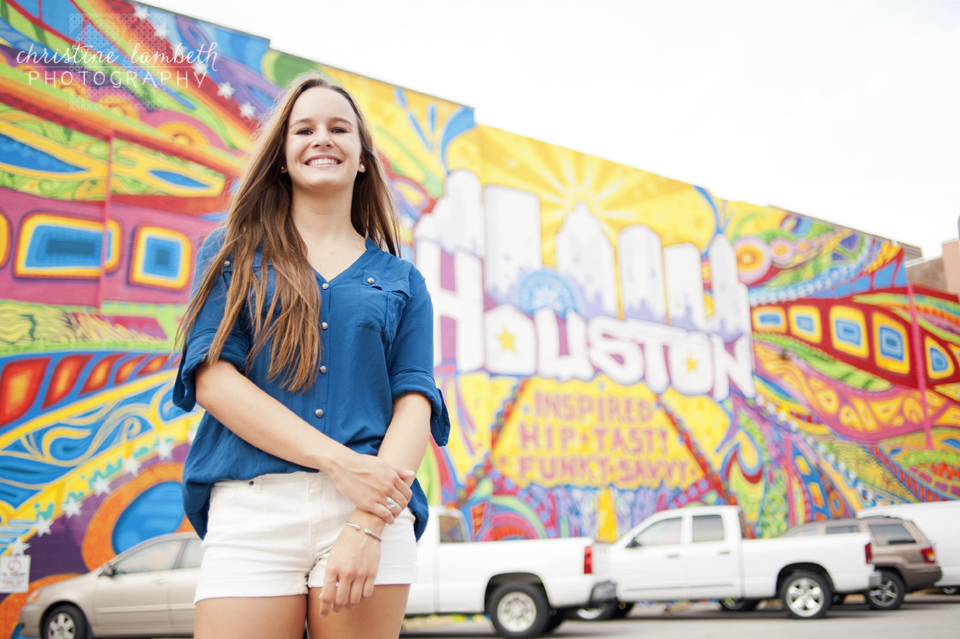 Senior photo in front of colorful mural - downtown Houston