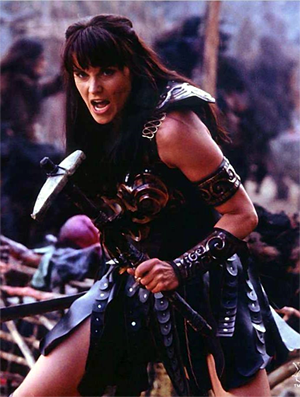 Lucy Lawless as Xena the Warrior Princess (TV Show) - she is wearing minimal leather armour and holding a stone axe with a fiercely determined expression on her face