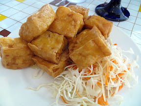 Tao Huu Tod appetizer, a dish of fried tofu caramelized with sweet and sour sauce Manao PDX Thai restaurant Portland Chef Chew