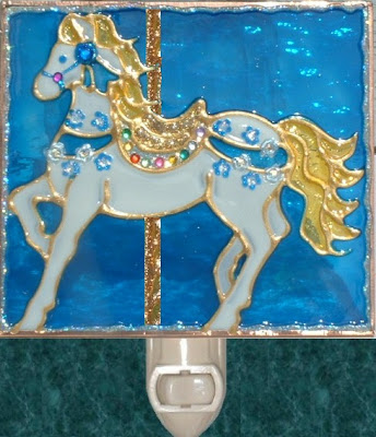 carousel horse in white and brilliant blue