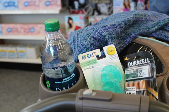 buying a bottle of water, two pacifiers, and eight double-A batteries