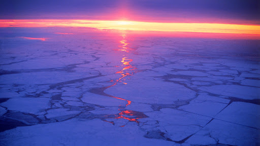 Ice Breaker Crossing the Frozen Baltic Sea at Sunrise, Between Sweden and Finland.jpg