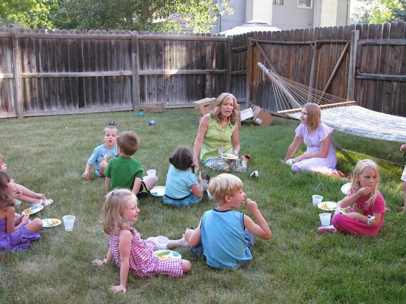 Kids and Volunteers Having a Snack